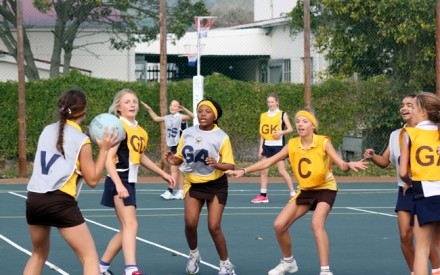 Two of the 24 U13 Eastern and Western netball teams enjoying the game during Sport at Backward Point Winter Netball Festival which was held from 14 – 16 June in Knysna. Photo: Fran Kirsten